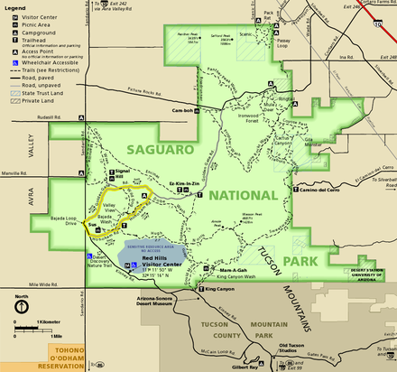 Map of the Tucson Mountain District, an irregular squarish shape colored green and surrounded by brown or gold-shaded areas not in the park