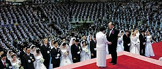 Unification Church - Moon presides over a mass blessing ceremony in 2010