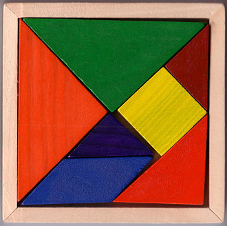 Tangram - Like most modern sets, this wooden tangram is stored in the square configuration.