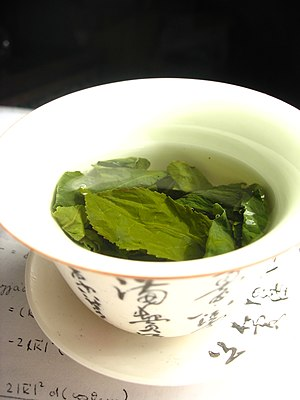 Steeping - Green tea leaves steeping in a gaiwan (type of tea cup)