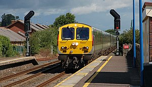 Application of railway signals - Bidirectional signalling in evidence at Poyntzpass with a passing Enterprise on NIR.