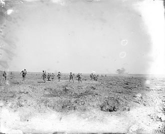 "5th Infantry Division (United Kingdom) - Men of the 12th (Service) Battalion, Gloucestershire Regiment (""Bristol's Own"") moving up in support in open order near Ginchy, France, 25 September 1916."
