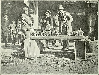 Cantonese people - Cantonese bazaar during Chinese New Year at the Grant Avenue, San Francisco, circa 1914. Names of shops are in Cantonese and there are four daily newspapers printed in the Cantonese language at that time, as there is already significant number of Cantonese people who have been there for generations.
