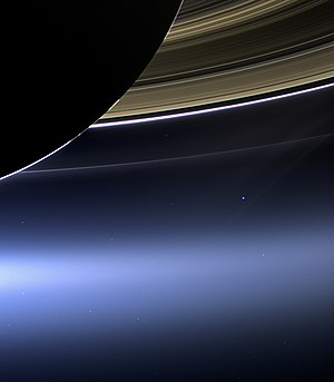 The Day the Earth Smiled - Earth can be seen as a blue dot underneath the rings of Saturn in this image taken by the Cassini spacecraft on July 19, 2013.