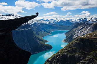 Trolltunga - The view of Trolltunga and Ringedalsvatnet with glimpses of the Folgefonna glacier in the background.