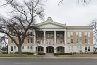 The Uvalde County Courthouse in Uvalde, Texas, was built in 1928 in neoclassical design. It is the fifth structure used as the county courthouse, having replaced the previous building constructed in LCCN2014631295.tif