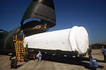 The first stage of a Titan IV launch vehicle is offloaded from a C-5B Galaxy aircraft for an official acceptance and dedication ceremony DF-ST-89-04975.jpg