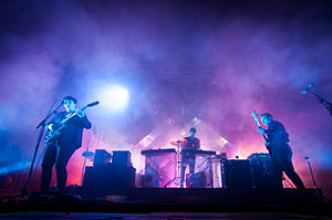 The xx performing at Ilosaarirock Festival in Joensuu, Finland, in 2012. Left to right: Romy Madley Croft, Jamie xx, Oliver Sim.