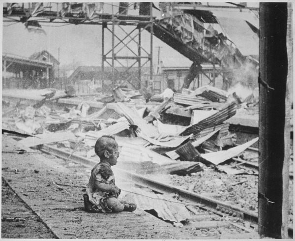 This terrified baby was almost the only human being left alive in Shanghai's South Station after brutal Japanese... - NARA - 535557.tif