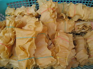 Burmese tofu - To hpu gyauk (Burmese tofu crackers) are sold in bundles  ready for deep frying.