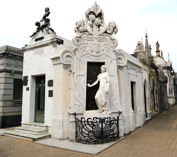 The mausoleum of the young girl, completed with a statue, representing her, with her hand on the door, her eyes looking away from her tomb.  Photo: Source: Tim Adams