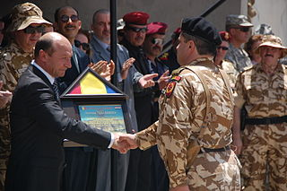 Traian Receives Romanian Flag Afghanistan Sescu