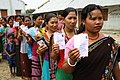 Tribal voters standing in a queue at a polling booth to cast their votes during the 1st Phase General Elections-2014, at East Balaram Thakur Para, Champaknagar under West Tripura Parliamentary constituency, Tripura.jpg