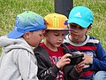 Trio of Boys outside Museum of the Great Patriotic War - Minsk - Belarus (27491219036).jpg