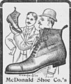 Two men, a shoe, and a giant shoe.jpg