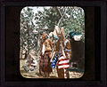 Two men, one wrapped in an American flag. 777a.jpg