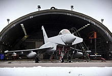 A No. 11 Squadron Eurofighter Typhoon outside a hardened aircraft shelter at Coningsby.