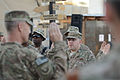 U.S. Airmen with the 455th Air Expeditionary Wing recite their re-enlistment oath during a ceremony officiated by Brig. Gen. Mark D. Kelly, left, the wing commander, at Camp Cunningham at Bagram Airfield 140911-F-LX971-088.jpg