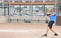 U.S. Coast Guard Chief Petty Officer Jeffrey Schmitt, a search and rescue controller at the 9th Coast Guard District Command Center in Cleveland, gets a hit during his unit's softball practice July 31 130731-G-KB946-012.jpg