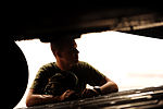 U.S. Marine Corps Lance Cpl. Russell Seese, assigned to Marine Medium Tiltrotor Squadron (VMM) 266, watches aircrews assigned to the 10th and the 6th Airlift Squadrons as they unload a U.S. Marine Corps MH-53E 100826-F-RR679-205.jpg