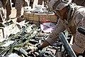 U.S. Marine Corps Staff Sgt. Ysa Rubio, an explosive ordnance disposal team leader with the 1st Explosive Ordnance Disposal Company, Combat Logistics Regiment 2, arranges M112 demolition charges during 130317-M-KS710-008.jpg