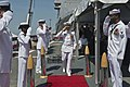 U.S. Navy Cmdr. Scott A. Jones, center, the commanding officer of the guided missile destroyer USS Donald Cook (DDG 75), departs after a change of command ceremony held aboard the ship after assuming command 130510-N-KE519-102.jpg