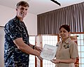U.S. Navy Religious Program Specialist 1st Class Cecilia Marrero, right, selected for promotion to chief petty officer, accepts a letter of commendation from Capt. Steven Wieman, commanding officer of Naval Air 130813-N-OX321-046.jpg