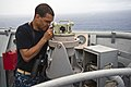 U.S. Navy Senior Chief Aviation Machinist's Mate Brian Edgington, assigned to the targets detachment at Fleet Activities Okinawa, Japan, measures the distance of a remote surface target from the bridge wing 130525-N-IY633-012.jpg