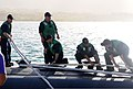 U.S. Sailors aboard the attack submarine USS Buffalo (SSN 715) cast off mooring lines at Apra Harbor, Guam 130111-N-LS794-005.jpg