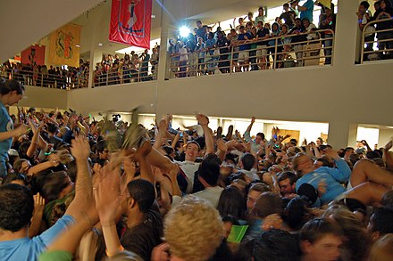 At the end of each semester, students organize a flash mob dance party in the library. UNC library flash mob rave.jpg