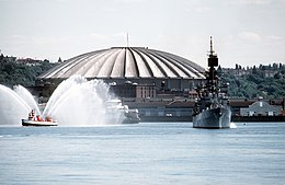 USS Leahy (CG-16) in front of the Seattle Kingdome Stadium on 6 October 1982 (6371846).jpg