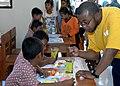 USS Vandegrift sailor work with Indonesian children 120530-N-IA840-255.jpg