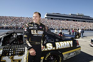 Ryan Newman stands beside his Number 39 Army C...
