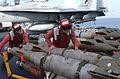 US Navy 020303-N-1587C-056 Loading bombs on aircraft aboard ship.jpg