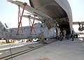 US Navy 030321-N-0226M-002 An HH-60H Seahawk helicophter from Helicopter Combat Support Squadron Five (HC-5) is loaded into a U.S. Air Force C-17 Globemaster III aircraft.jpg