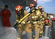 US Navy 040427-N-6187M-003 Members assigned to USS Enterprise (CVN 65) Damage Control Team test their fire-fighting agent