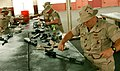 US Navy 040808-N-3750S-002 Naval Mobile Construction Battalion Two Three (NMCB-23) members disassemble, clean and reassemble their M-16 rifles.jpg