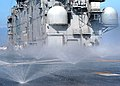 US Navy 040929-N-6616W-002 The Amphibious Assault ship USS Saipan (LHA 2) conducts a test of her flight deck countermeasure wash down system.jpg
