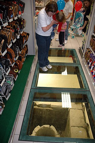 Glass floor - Glass in-floor display case showing Roman artifacts in Naples, Italy
