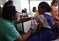 US Navy 050826-N-9407V-003 Hospital Corpsman 2nd Class Larosa A. Watson, assigned to the amphibious assault ship USS Boxer (LHD 4), gives a Marshallese student an immunization during a community health fair in Majuro, Marshall.jpg