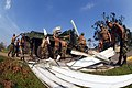 US Navy 050909-N-5526M-004 U.S. Navy Seabee's assigned to Naval Mobile Construction Battalion Four Zero (NMCB-40) load metal Debris left behind from hurricane Katrina.jpg