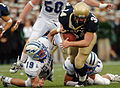US Navy 051008-N-9693M-015 U.S. Naval Academy Midshipman full back Matt Hall is pulled down by Air Force free safety Ty Paffett (19) and free safety Bobby Giannini (11) during the 2nd quarter of play against the Falcons.jpg