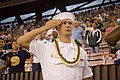 US Navy 051112-N-8157C-056 U.S. Navy Electronics Technician 3rd Class Irvine R. Rash of Pearl Harbor Naval Shipyard, salutes during the National Anthem in Aiea, Hawaii.jpg