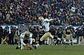 US Navy 051203-N-0295M-053 The U.S. Naval Academy Midshipman Joey Bullen of St. Simons Island, Ga. kicks an extra point following a Reggie Campbell touchdown.jpg