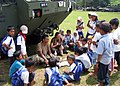 US Navy 060222-N-2527S-014 Builder Constructionman Ronald Showers and Builder 2nd Class Jessica Lott assigned to the Naval Mobile Construction Battalion Four (NMCB-4) share lunch with some local children at the Tiptipon School.jpg