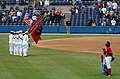 US Navy 060427-N-4757S-043 Color Guard members from USS Harry S. Truman (CVN 75) parade the colors during the national anthem at the beginning of a Norfolk Tides baseball game at Harbor Park.jpg