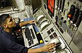 US Navy 060622-N-4166B-035 Gas Turbine Technician Mechanical Fireman John C. Triesch monitor the main engine room propulsion systems aboard the guided-missile destroyer USS Russell (DDG 59).jpg