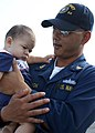 US Navy 060908-N-8544C-042 Senior Chief Hospital Corpsman Torsak Vimoktayon holds his six-month old son upon his return to Mayport.jpg