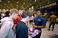 US Navy 070330-N-4515N-009 Special Warfare Boat Operator 2nd Class Ronnie Longoria from Special Boat Team 20 talks with high school students attending the National High School Wrestling Championship at the Virginia Beach Conven.jpg