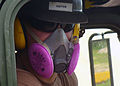 US Navy 070831-N-3713P-001 Equipment Operator Constructionman Apprentice Chance R. Keiter, attached to Naval Mobile Construction Battalion (NMCB) 4, wears a respirator while hauling rock from a recent blast at Orote Point Quarr.jpg